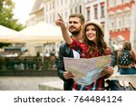 couple of travelers using map... | Shutterstock . vector #764484124