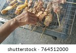 pig roasting   pork barbecue | Shutterstock . vector #764512000