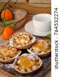 apple tangerine tarts .... | Shutterstock . vector #764532274