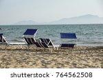 sun loungers empty at seaside... | Shutterstock . vector #764562508