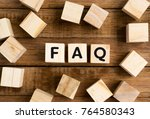 faq word on wooden block on top ...   Shutterstock . vector #764580343