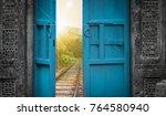 railway tracks behind open door | Shutterstock . vector #764580940