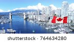 Small photo of Canadian flag in front of view of False Creek and the Burrard street bridge in Vancouver, Canada.