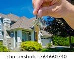 hand holding the keys for big... | Shutterstock . vector #764660740