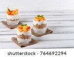 persimmon creamy trifle in... | Shutterstock . vector #764692294