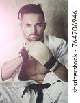 sportsman portrait in gloves....   Shutterstock . vector #764706946