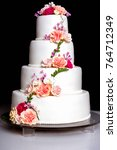 white wedding cake with flowers ... | Shutterstock . vector #764712349