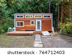 small wooden cabin house.... | Shutterstock . vector #764712403