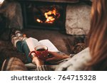 woman in woollen socks by the... | Shutterstock . vector #764715328