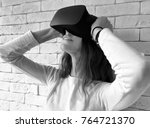 young woman looking through...   Shutterstock . vector #764721370