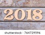 cutout wooden number 2018 on...   Shutterstock . vector #764729596