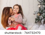 young mom having kissing her... | Shutterstock . vector #764732470