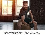 athletic man training biceps at ... | Shutterstock . vector #764736769