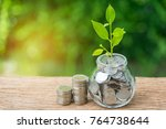 grow sprout plant in saving jar ...   Shutterstock . vector #764738644
