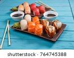 delicious appetizing nigiri... | Shutterstock . vector #764745388