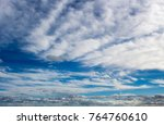 Small photo of Picturesque middle level stratocumulous , cumulous and altostratus with low stratus cloud formations on a sunny afternoon in winter are contrasted against the blue Australian sky.