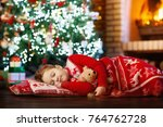 child sleeping at fire place on ... | Shutterstock . vector #764762728