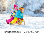 little girl and boy enjoying... | Shutterstock . vector #764762734