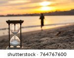 hourglass in the dawn time.... | Shutterstock . vector #764767600