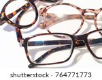 Stock photo multiple pairs of reading glasses on a white background macro close up shot 764771773