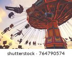 people riding rides and... | Shutterstock . vector #764790574
