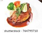 half of appetizing roasted... | Shutterstock . vector #764795710