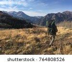 hunter walks along a... | Shutterstock . vector #764808526