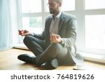 businessman doing yoga in lotus ... | Shutterstock . vector #764819626