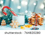 christmas gingerbread and milk... | Shutterstock . vector #764820280