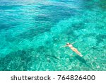 Young Woman Swimming In The...