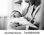 mother with a newborn baby | Shutterstock . vector #764884048