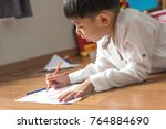 kid boy drawing with color... | Shutterstock . vector #764884690