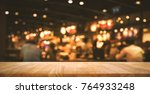 wood table top  bar  with blur... | Shutterstock . vector #764933248