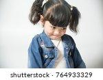 Stock photo asian little girl shy 764933329