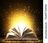 open book on wooden vintage... | Shutterstock . vector #764973496