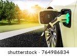 ev car or electric car at... | Shutterstock . vector #764986834