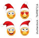 set of emoji with santahat....   Shutterstock .eps vector #764987116