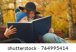 little boy and his mother are... | Shutterstock . vector #764995414