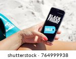 woman on the beach with a cell... | Shutterstock . vector #764999938