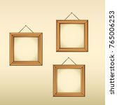 empty frames hanged on a wall | Shutterstock .eps vector #765006253