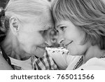 middle aged woman hugging her... | Shutterstock . vector #765011566