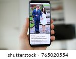 Small photo of LENDELEDE, BELGIUM- NOVEMBER 29TH 2017: a hand holding a new Samsung Galaxy S8 mobile phone which displays the engagement of Prince Harry and Meghan Markle on the touch screen. Illustrative editorial.