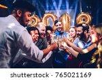 group of friends celebrating... | Shutterstock . vector #765021169