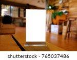 mock up menu frame standing on... | Shutterstock . vector #765037486