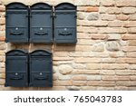 several wall mounted mailboxes... | Shutterstock . vector #765043783