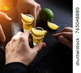 two mexican men at bar drinking ... | Shutterstock . vector #765048880