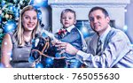 happy young family smiling... | Shutterstock . vector #765055630