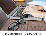 woman using laptop on wooden...   Shutterstock . vector #765057544