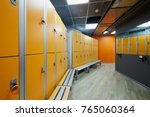 room with orange lockers at... | Shutterstock . vector #765060364