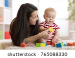mom with baby boy playing at... | Shutterstock . vector #765088330